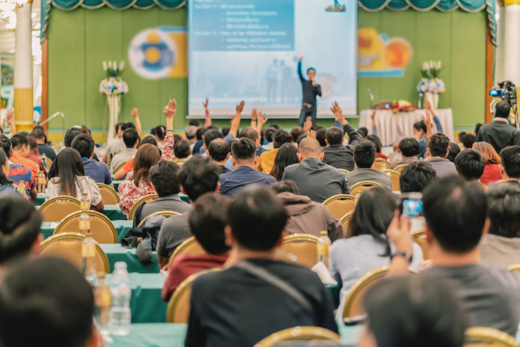 audience and speaker at an international presentation